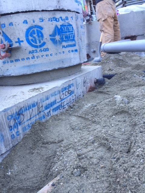 Outdoor shot of piping and concrete work - MV Mechanical Inc.