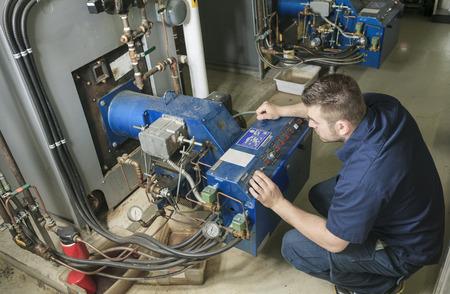 Technician working on mechanical room system - MV Mechanical Inc.